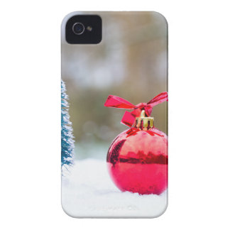 Little christmas tree and red bauble in snow iPhone 4 case