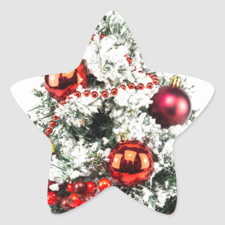 Little decorated christmas tree with baubles star sticker