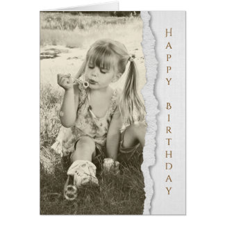 little girl blowing bubbles for birthday card