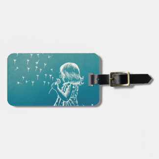 Little girl blowing on a dandelion luggage tag