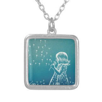Little girl blowing on a dandelion silver plated necklace
