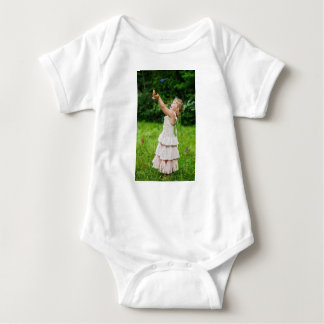 Little Girl Catching a Butterly Baby Bodysuit