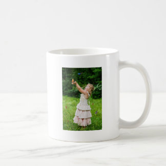 Little Girl Catching a Butterly Coffee Mug