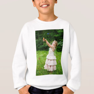 Little Girl Catching a Butterly Sweatshirt