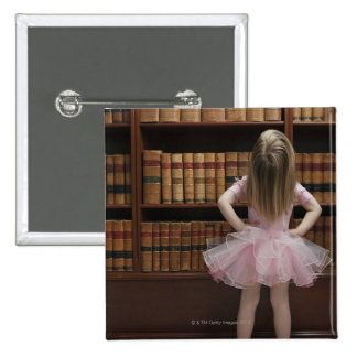 little girl in tutu reading book covers in 2 inch square button