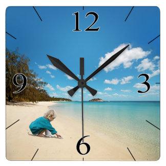 Little Girl on the Beach with Seashells Clocks
