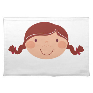 Little girl on white placemat