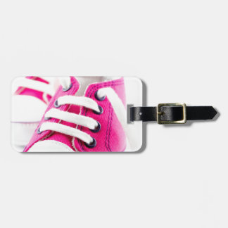 Little girl pink shoes sneakers luggage tag