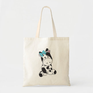 LITTLE GRAY AND WHITE COW WITH TURQUOISE BOW