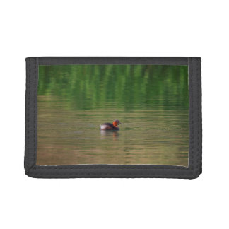 Little grebe duck in breeding plumage trifold wallets