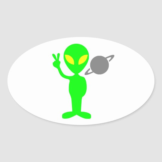 Little Green Alien Next to the Planet Saturn Oval Sticker