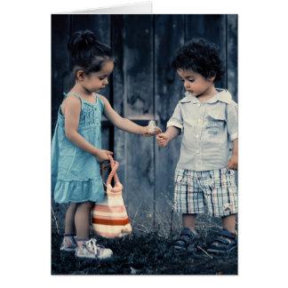 Little kids sharing blank card