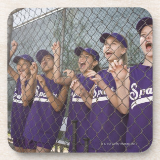 Little league team cheering in dugout beverage coasters