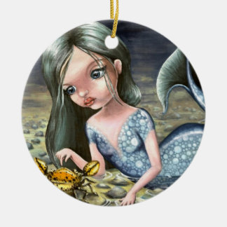 Little mermaid playing with a crab ceramic ornament