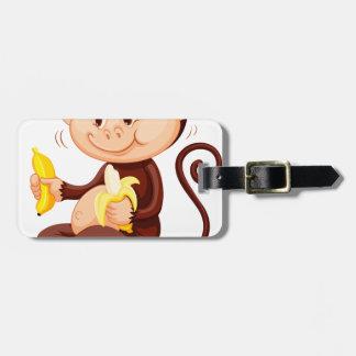 Little monkey eating bananas luggage tag