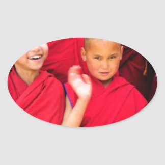 Little Monks in Red Robes Oval Sticker