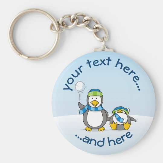 Little penguin getting a snow ball basic round button keychain