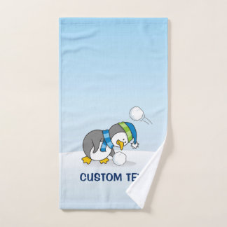 Little penguin getting a snow ball bath towel set
