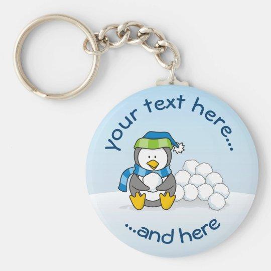 Little penguin sitting with snowballs basic round button keychain