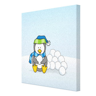 Little penguin sitting with snowballs canvas print
