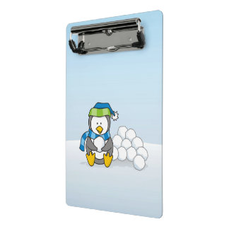 Little penguin sitting with snowballs mini clipboard