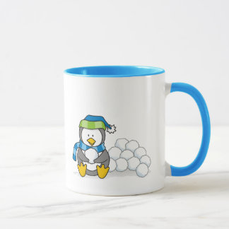 Little penguin sitting with snowballs mug