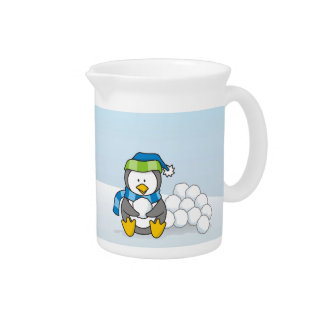 Little penguin sitting with snowballs pitcher