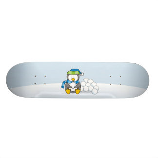 Little penguin sitting with snowballs skate board