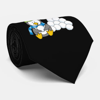 Little penguin sitting with snowballs tie