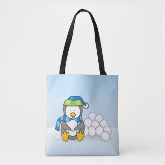 Little penguin sitting with snowballs tote bag