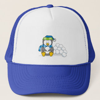 Little penguin sitting with snowballs trucker hat