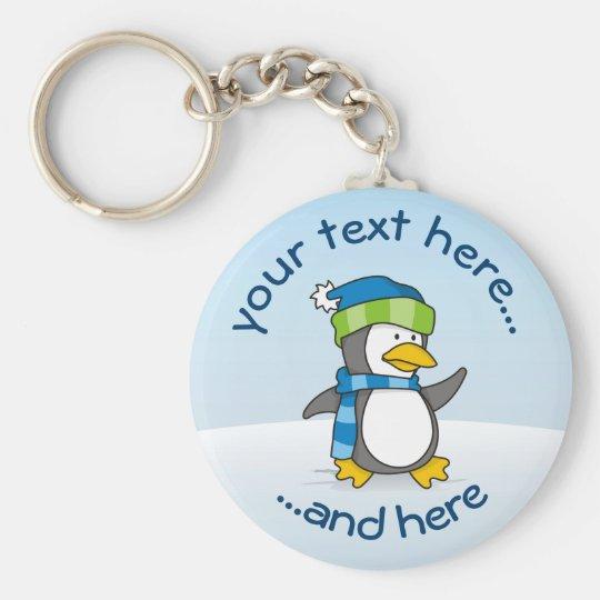 Little penguin walking on snow keychain