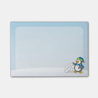 Little penguin with snow balls waving post-it® notes