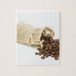Little sackcloth with coffee beans puzzles