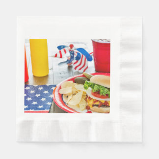 Loaded cheeseburger at a patriotic cookout paper napkins