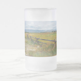 log fence by a prairie frosted glass beer mug