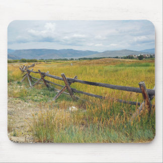 log fence by a prairie mouse pad
