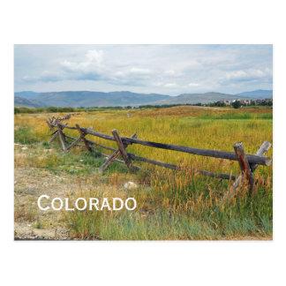 log fence by a prairie postcard