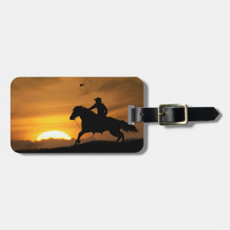 Lone Riding Cowboy in the Sunset Luggage Tag