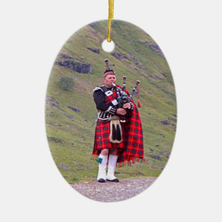 Lone Scottish bagpiper, Highlands, Scotland Ceramic Ornament