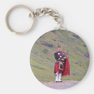 Lone Scottish bagpiper, Highlands, Scotland Keychain