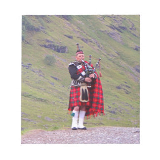 Lone Scottish bagpiper, Highlands, Scotland Notepad