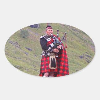 Lone Scottish bagpiper, Highlands, Scotland Oval Sticker