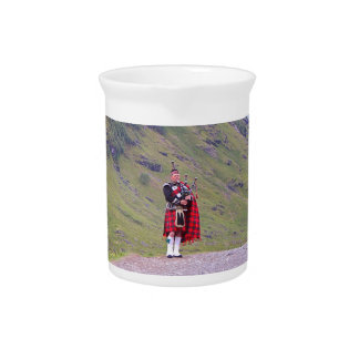 Lone Scottish bagpiper, Highlands, Scotland Pitcher