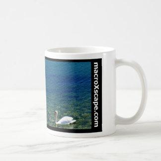 lone swan in blue ocean coffee mug