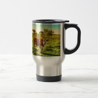 Lonely Cow in the Meadow Facing the Camera Travel Mug