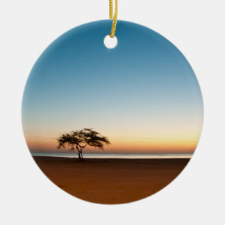 Lonely tree at sunrise in Kuwait Round Ceramic Ornament