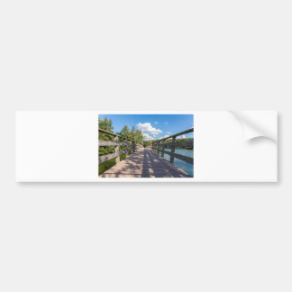 Long wooden bridge over water of pond bumper sticker