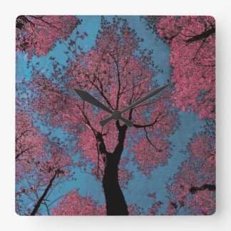 Looking Up at a Blue Sky & Pink Trees Square Wall Clock