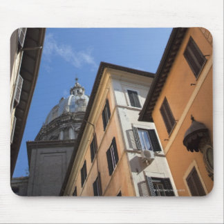 looking up at colourfully painted buildings and mouse pad
